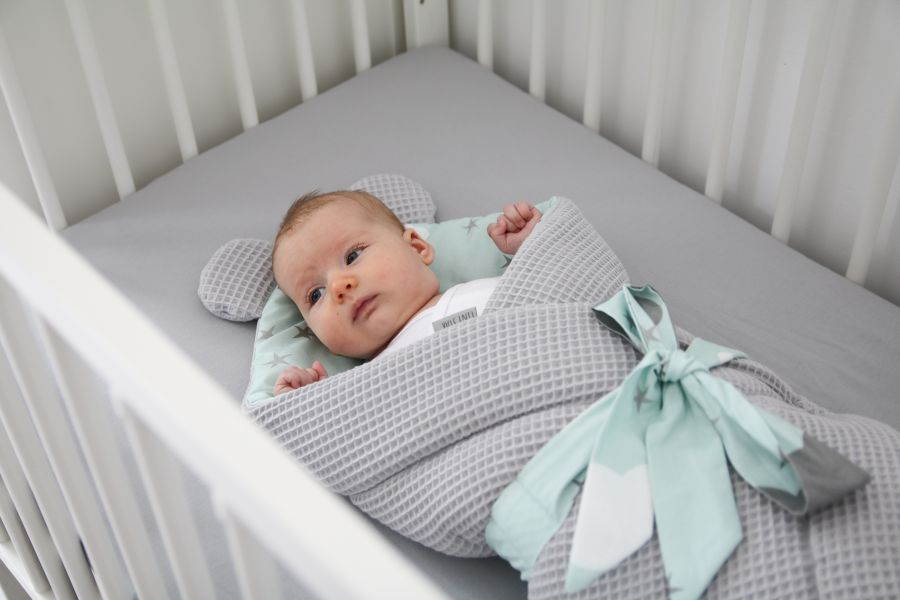 What should a newborn sleep in?